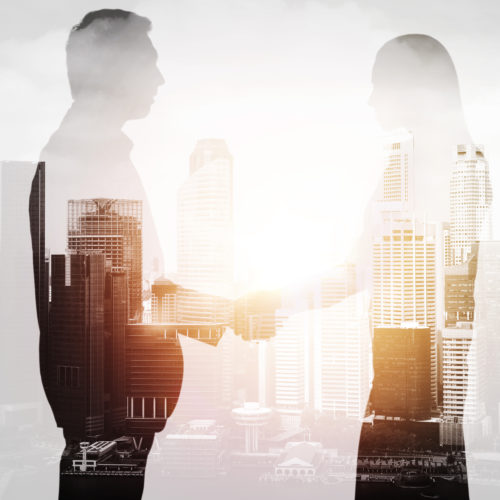 Business,,Partnership,And,Cooperation,Concept,-,Businessman,And,Businesswoman,Silhouettes
